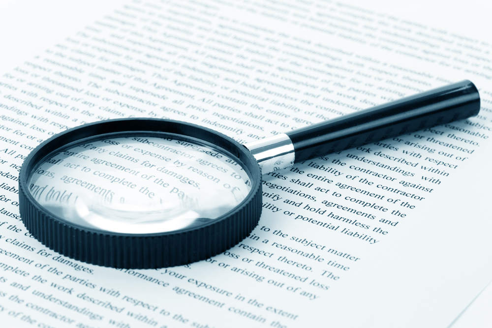 magnifying glass looking at fine print